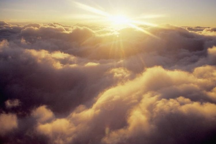 Sunshine Above Cloud Cover --- Image by © Mark A. Johnson/Corbis